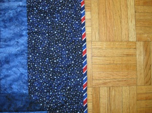 The binding. I love striped binding! I cut the stripes on the bias to wrap around the quilt edges. Lovely!