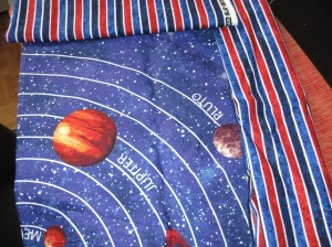 The planet panel and stripe (same as binding) I originally planned to use for the backing. Naturally, disaster struck in two forms. First, the stripe was no longer available. Then,...